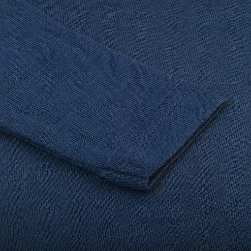 Heldragt i 100% uld. Blå med knapper i ben og skulder. Papfar. Ærme.