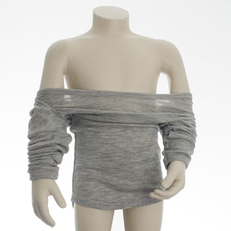 EN body med amerikansk lukning har stort nok halshul til, at den kan trækkes ned over skuldrene.