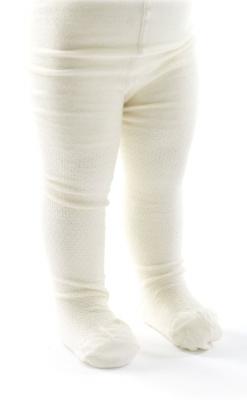 Strømpebukser med mønster på benene. Hvid uld. SmallStuff.