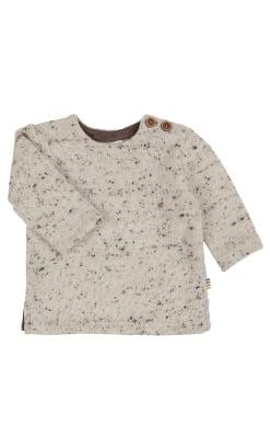 Trøje i tyk strikket uld. Hvid merinould med sorte nister. Slids og træknapper. Joha.