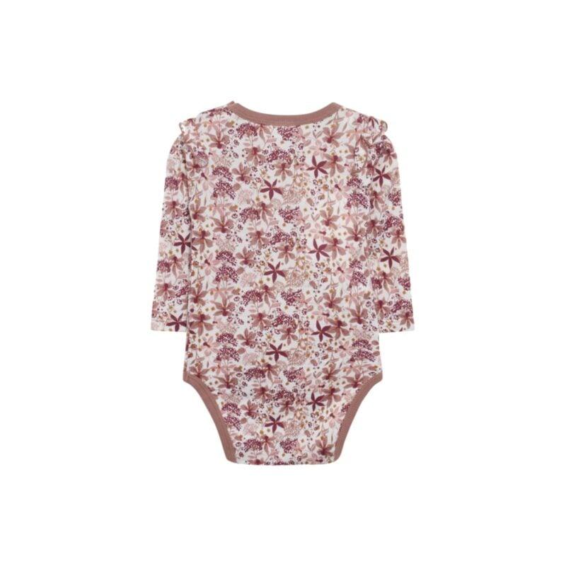 Bagsiden af Hust & Claire body i uld silke. Bodyen er i blomstret mønster i rødbrune nuancer. Flæsekanter på skuldre.